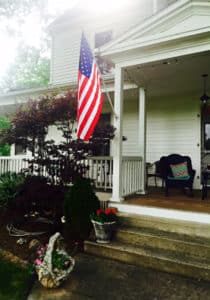 image of the front porch of the inn with American flag