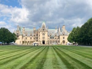 A view of the Biltmore Estate Mansion from the green field in front of the property.