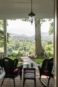 A view of the mountains from the porch at Oak Hill on Love Lane. Beautiful green rolling hills in the distance.