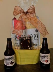 Waynesville snack basket filled with locally made popcorn, fudge, and Waynesville Soda!