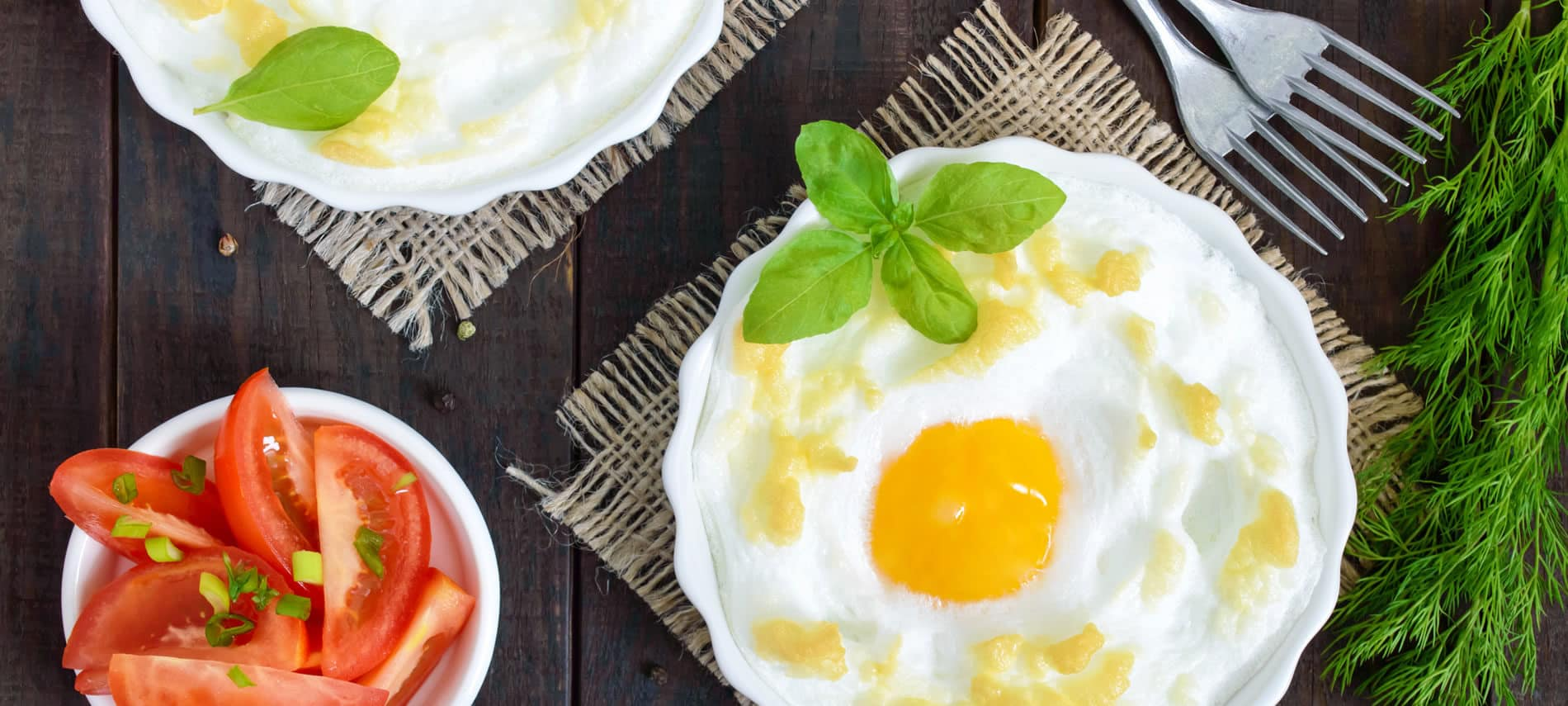 fresh tomatoes, eggs in a cloud on burlap placemat