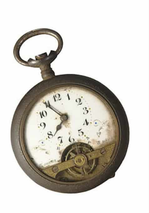 old fashioned time piece with white background