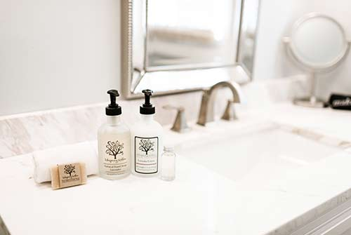 Bathroom photo with focus on custom toiletries