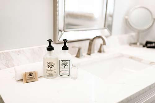 Bathroom photo with focus on custom toiletries