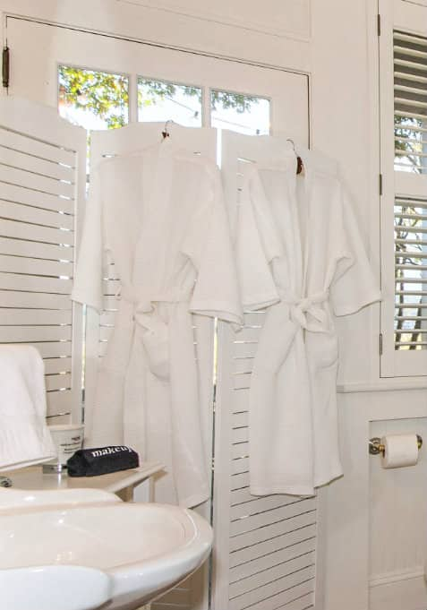 white bathroom with white eyelet curtains