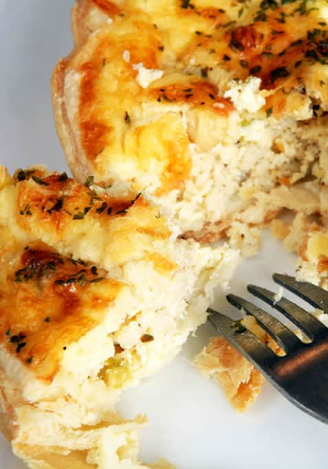 quiche with fork on white plate